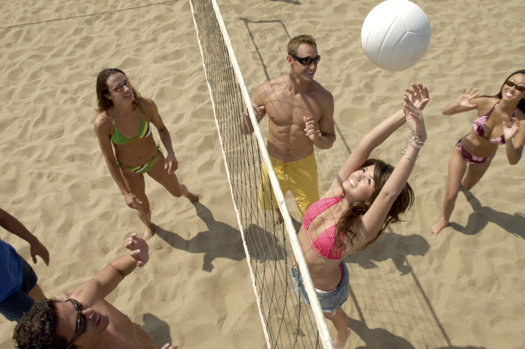 Group Playing Volleyball on Beach --- Image by © Royalty-Free/Corbis